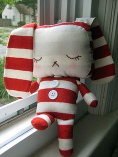 I love the bold stripes on this floppy-eared dog softie.
