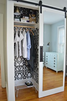 How to make a DIY mirrored barn door, from an old door, and older leaning mirror, for a small closet in a bedroom.