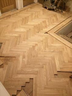 Prime grade oak parquet floor with a walnut tramline being laid in the Hallway.