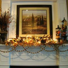 Great mantel decor from Adventures in Decorating blog...the lights really add something...I've always used lights with little plastic pumpkins on them...but I like the white lights too