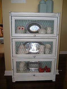 Old bookshelf, painted and chicken wire replaced the glass.  Farmhouse vintage!