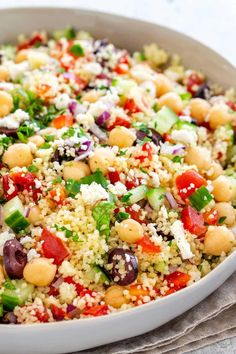 Mediterranean couscous salad with a fresh lemon herb dressing. Semolina pasta tossed with colorful vegetables, feta cheese, olives, and garbanzo beans. #couscous #mediterranean #salad #semolina #summerrecipes #couscoussalad