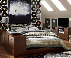 Rustic Music Themed Room -- aa's Nursery is Music Themed, so I can incorporate many of the same pieces, and add more mature articles like the albums on the wall, concert prints (lord knows we have plenty) and adding color to the walls.   Ultimate Ollie Bedroom | PBteen