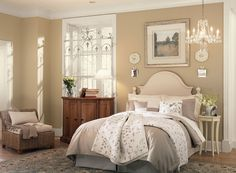 A light neutral storybook bedroom from Benjamin Moore with interior paint color palette: Truffle AF-130 (walls), Linen White 912 (ceiling), & Alabaster OC-129 (trim)