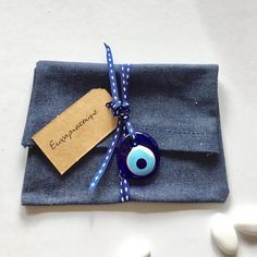Denim gift bag with Mediterranean blue glass evil eye charm. The bag is empty ready for you to fill with your special gift. Other customisation available, please message me. Bombonieria, baptism, Easter, weddings, baby shower, party.....