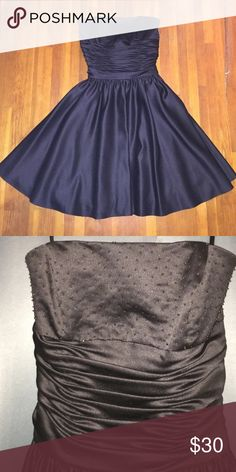 ONE DAY SALE: Black Dress Semi formal black dress with a rushed corset like middle and a strapless top. Zips in the back and ties. (Sorry, not ASOS but I wanted it to be seen. I'm unsure of the brand.) Asos Dresses Strapless