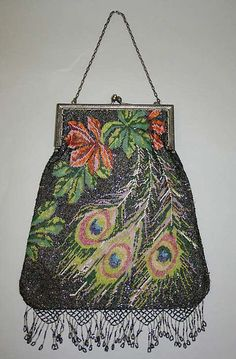 This is a purse from the 1920s. Purses at this time became larger so that women could carry cosmetics, cigarettes, etc. with them. This piece is part of the Met's collection.