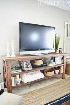 DIY Rustic TV Console, love this but wish they had posted instructions so I could have my dad make me one