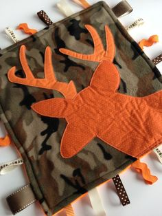 Leah Hite I am going to have to make this for you someday.   Fleece Hunter Tag Blanket Deer on Camouflage & Safety Orange
