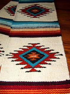 """Just ONE of the many different designs of lovely handwoven wool table runners we have in our ebay store. 10x80"""" with tassled corners. $39.95 w/ free shipping! #homedecor #tablerunner #southwestern #textiles #woven"""