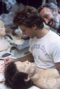 Stan Winston goofs for the camera unbeknownst to his young protege, John Rosengrant.