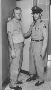 Elvis and Vernon going into his mother, Gladys' hospital room.