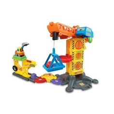 """Little construction workers will love exploring the Go! Go! Smart Wheels® Learning Zone Construction Site™ by VTech®! Roll the SmartPoint® excavator over five SmartPoint® locations to hear different phrases, music or fun sound effects. Press the toy excavator's light-up button to hear three sing-along songs and learn the letter """"E"""" and the vehicle name. Build motor skills by turning the handle to raise and lower the basket elevator, raising and lowering the elevator, dropping shape pieces…"""