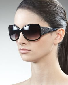 f034cecc30 Embossed-Temple Sunglasses by Givenchy at Neiman Marcus. Black Round  Sunglasses