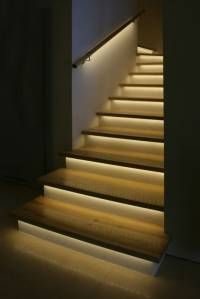 The lighting on these stairs provides a functional perpose of illuminating them at night, however it also showcases the texture of the wood stairs.