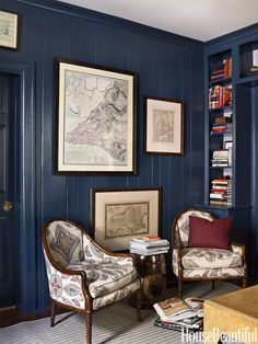By painting the paneled walls and cabinets of the library in a Charlotte, North Carolina house, a deep blue, designer Lindsey Coral Harper gave a sliver of a room impact.   - HouseBeautiful.com