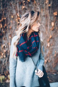 Gray sweater, navy and red scarf, and black purse with chain strap || Wanderlust