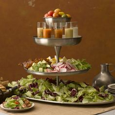 Tiered Salad Bar.  like the serving of dressing in small glasses.