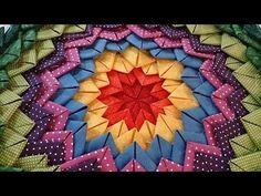 1 quadrado pra base de 40 x 40 cm 1 quadrado da cor central de 6,5cm 1 linha - 4 triangulos 2 linha - 8 triangulos 3,4,5,6 - 16 triangulos para cada linha 7,...