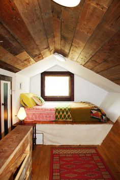 Erin's Warm & Wood-Wrapped Austin Bungalow on a Budget. This would be cool in one of the tiny home lofts for the kids. Use as a day bed. Pull out bed underneath, then cover again with long bed skirt. Attic Bedrooms, Home Bedroom, Bedroom Nook, Design Bedroom, Bedroom Decor, Bedroom Ideas, Dream Bedroom, Attic Design, Master Bedroom