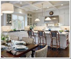 the lights are beautiful! black counters, white cabinets, grey marble island