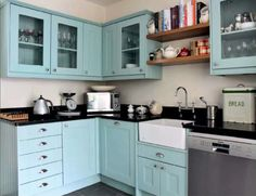maybe paint bottom cabinets very light green or blue that looks good w/metal cabinets