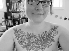 """Flower tattoos always have a softness, as does this beautiful and decorative tattoo. The  phrase translates to: """"Sing my heart. Speak my mind."""" http://thestir.cafemom.com/beauty_style/190674/25_floral_tattoos_to_beautifully"""
