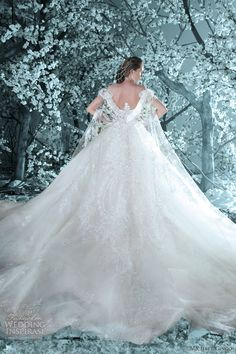 I'm not one for princess-y, over-the-top ball gowns, but isn't this MAGICAL? I just had to pin it! By Michael Cinco.