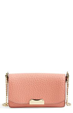 Chic rose pink Burberry wallet with a twinkling gold chain.