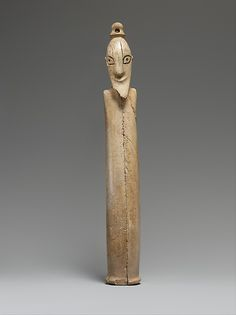 A tusk figurine of a Man Egypt, Pre-Dynastic Late Naqada I - Early Naqada II c.3900-3500 BC Tusk figures belong to a group of abbreviated figurines made in the Predynastic Period.