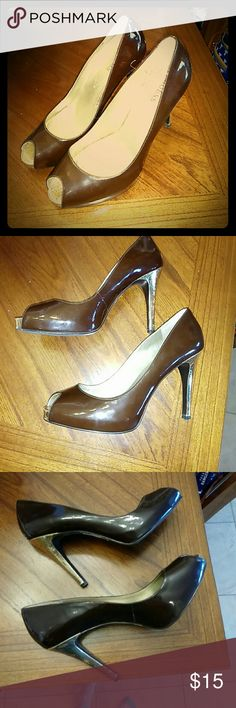 Guess heals, brown with gold heel Gently worn, one scratch on the back of one heel. Guess Shoes Heels