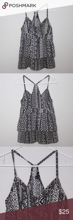 "American Eagle Outfitters Black & White Boho Tank Bust: approx. 15.5"" Length: approx 24"" (shoulder to hem)  A cute top with classic black and white boho pattern all around. In great condition. Four button detail on front (see 3rd photo). Zippers up from left side. No holes, stains or imperfections. Comes from a smoke free environment.  Bundles welcome Offers welcome through offer button. ❌NO trades, please. ⚡️Same/Next day shipping American Eagle Outfitters Tops"