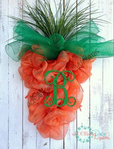 Carrot Easter Wreath by aDOORableDecoWreaths on Etsy/ @Cathy Oates Dukes  I know you could make this yourself.