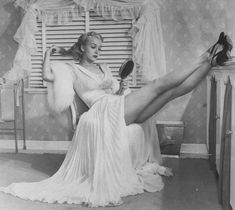 Peignoir. I wish we were still this elegant at bed time. Now its anything with words on your derrière