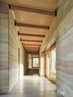 Modern Neutral Hall with Slatted Ceiling