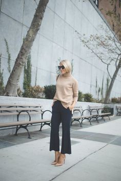 8 Ways To Style A Turtleneck This Fall | 5. A turtleneck sweater looks ultra chic when subtly tucked into flared pants, a perfect fall work outfit.