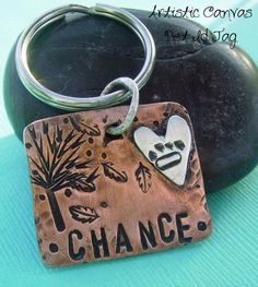 Artistic Canvas Pet Id Tag hand-stamped with pets name and phone number with a pawprint heart in sterling silver and copper tag, falling leaves, autumn, on etsy $18.00