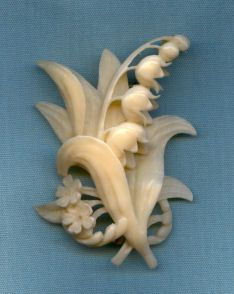 Carved ivory lily of the valley brooch