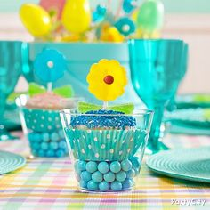 Plant a cheerful spring daisy atop a cupcake at each place-setting to complete your shades-of-blue Easter tablescape.