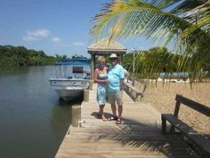 Friends of Howard and Wilana Oldham on a dock in Hopkins Caye, Belize – The standard of living in the Cayo District is good.   In the US, having amenities is a big thing and convenience is really big. Being able to go shopping 24/7 in the US is what it's all about. It is not that way here in Belize.