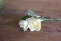 A single white Freesia for an understated groom's buttonhole #wedding #flowers #florist #buttonhole #freesias
