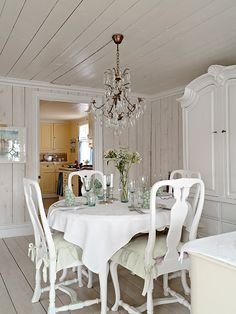Love the round table and white chairs