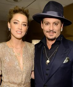 Busy stars: Amber and Johnny both took to the stage to present awards