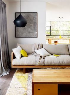 Our Latest Color Crush Is Perfect for Summer via @MyDomaine   PHOTO:  Mark Tuckey     Pillows and poufs make for perfect acidic accessories. In this home, chartreuse décor accents keep the eye dancing from surface to surface, creating color cohesion throughout. Each piece feels purposeful in connecting one room to the next.   Gray + yellow decor