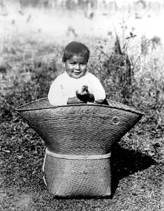 "A Choctaw baby peeks out of a handwoven Choctaw rivercane pack basket at Lacombe, LA. The picture, taken in 1909, appeared in David Bushnell, Jr.'s article, ""The Choctaw of Bayou Lacombe."" Photo courtesy Center for Regional Studies, SLU."