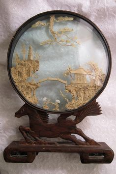 Vintage Cork Carving Framed in a Lacquer Shadow Box, Carried on a Carved Wooden Horse....