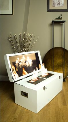 The Malle à Feu is a simple, white trunk that opens to reveal a two-flame ethanol fire inside. They also make a travel-size box......