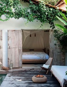 Beachy bedroom opening to a patio