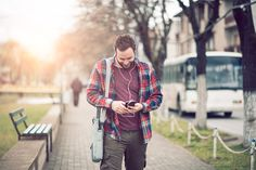Handsome Man Talking on Smartphone and Walking on City Street - Photo
