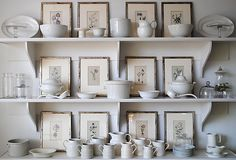 Love how it's a combo of framed art with dishes. Want to do this with my Fiestaware!